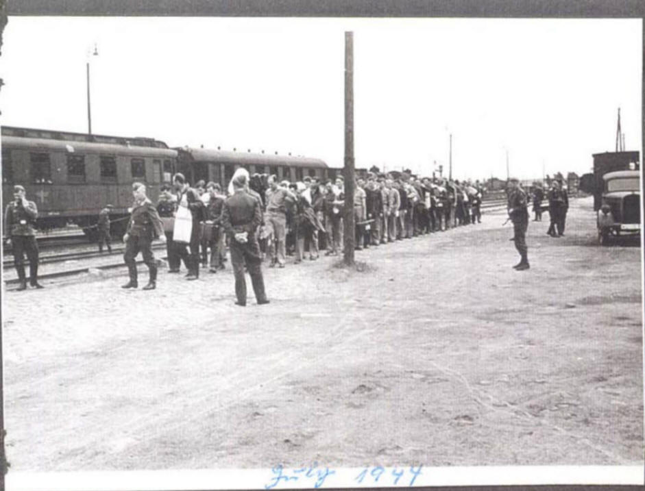 Prisoners of War at train station,  awaiting march to Stalag Luft I camp